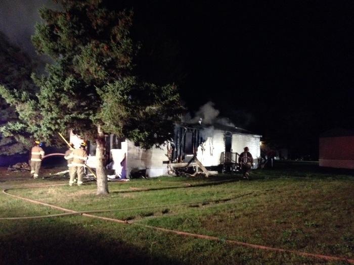 Occupants escape trailer fire